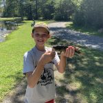 Shane Catching a Fish at the Pond