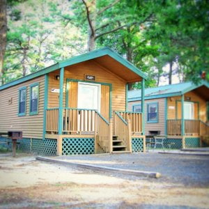 Our deluxe cabin is perfect for the in between camping experience. Fits a family…